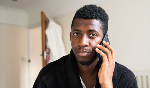 man on phone looking worried