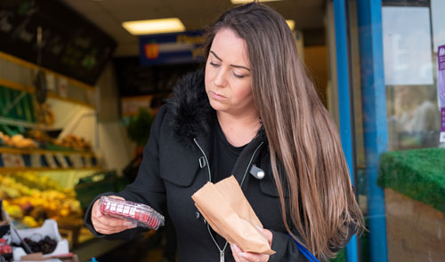 woman food shopping looking worried