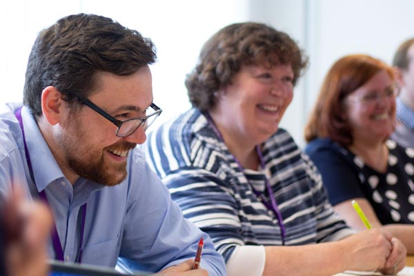 colleagues laughing in meeting