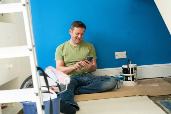 Man sat on floor with phone