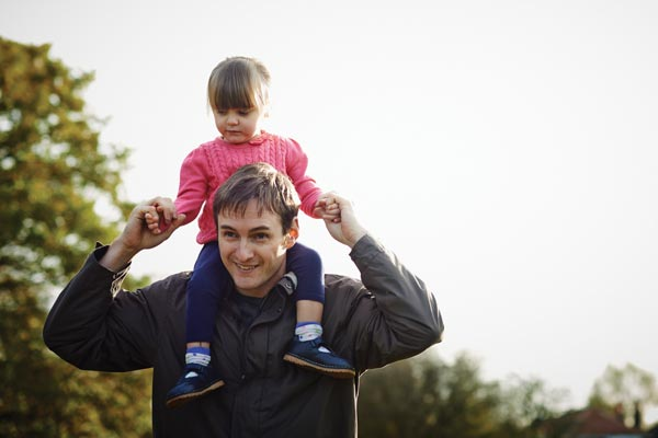 man in park with daughter