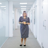 woman standing in the office with tea