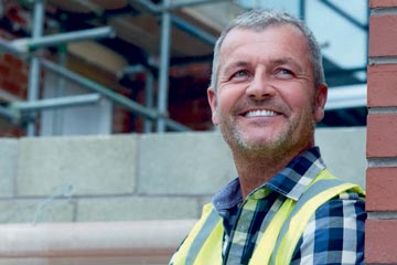 Smiling man on a building site