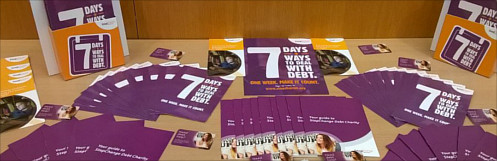 photos of stepchange leaflets on a table