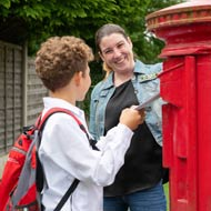 mum and son posting letter