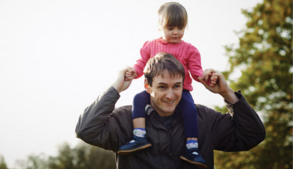 man with toddler on shoulders